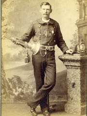 A fireman in uniform in the early days of the Pensacola's