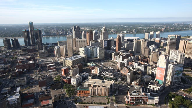 An aerial view of downtown Detroit, the Renaissance Center and the Detroit River on June 14, 2012.