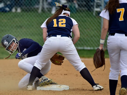 Chambersburg's Caeley Etter, left, checks in at second
