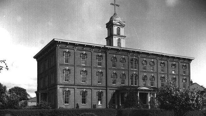 Sacred Heart Academy is seen in 1886 at 370 Cottage St. NE. It was established in 1863 by the Sisters of the Holy Names. The building was demolished in June 1971. St. Joseph's has taken over the property. There is a parking lot and part of the gymnasium where Sacred Heart was in downtown Salem.
