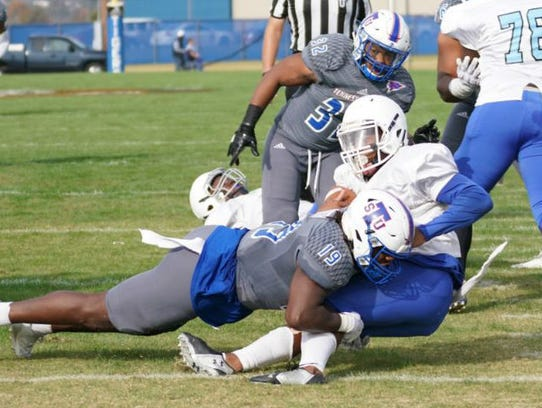 Tennessee State linebacker Justin North (19) tackles