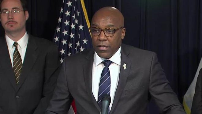 Illinois Attorney General Kwame Raoul, who has tested positive for COVID-19, speaks at a Chicago news conference in 2019.