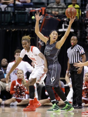 Michigan State's Aerial Powers (23) tries to control a loose ball against Ohio State's Alexa Hart (22) during the first half of an NCAA college basketball game at the Big Ten Conference tournament Saturday, March 5, 2016, in Indianapolis. (AP Photo/Darron Cummings)