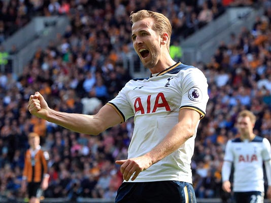 Tottenham Hotspur's Harry Kane celebrates scoring his side's third goal against Hull City during the English Premier League soccer match at the KCOM Stadium, Hull, England, Sunday May 21, 2017. (Danny Lawson/PA via AP)
