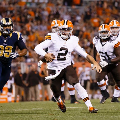 Cleveland Browns quarterback Johnny Manziel (2) runs in for a touchdown in the third quarter against the St. Louis Rams at FirstEnergy Stadium.