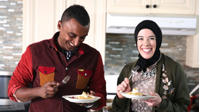 Chef/host Marcus Samuelsson tests out some home cooking with Detroit pastry chef Lena Sareini on PBS' 'No Passport Required.'