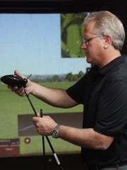 Troy O'Donnell, of Lumpy's Discount Golf Store,  replaces the shaft on a driver for a customer on Monday.