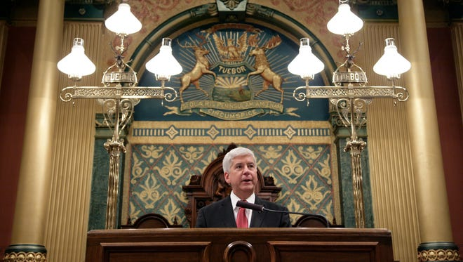 Michigan Gov. Rick Snyder delivers his State of the State address to a joint session of the House and Senate on Tuesday at the state Capitol in Lansing. (AP Photo/Al Goldis)