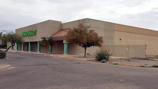 A vacant building that once housed a grocery store and a swap mart sits on property that will be redeveloped with new apartments on Warner Road just west of Arizona Avenue in Chandler.