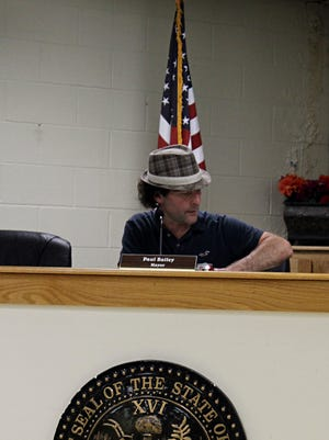 Erin Mayor Paul Bailey looks over the proposed budget for the next fiscal year for the city.