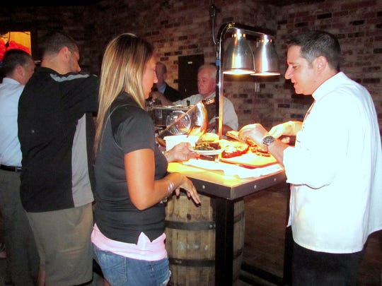 Guests sample some of the fare at Virgil's Real BBQ