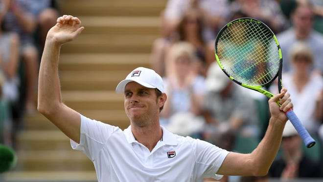 Thousand Oaks High graduate Sam Querrey celebrates after finishing off Jo-Wilfried Tsonga on Saturday to reach the fourth round of Wimbledon. The match was resumed Saturday after being suspended by darkness Friday.