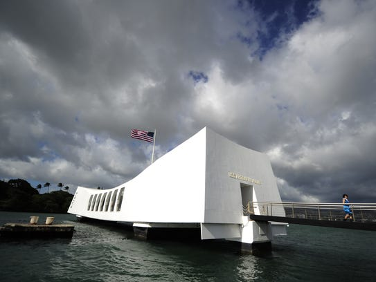 Visitors tour the USS Arizona memorial at the Pearl