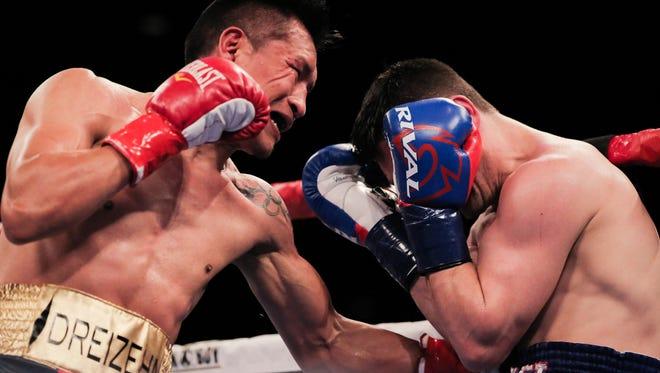 Francisco Vargas (left) lands a brutal body shot on opponent Rod Salka Thursday at Fantasy Springs Resort Casino in Indio. (Brandon Magpantay/Special to The Desert Sun)