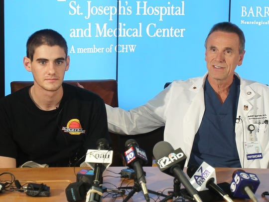 Dr. Robert Spetzler talks about Sam Schmid's brain injury during a press conference at Barrow Neurological Institute in Phoenix. Sam Schmid, an Arizona college student believed to be brain dead and poised to be an organ donor, miraculously recovered just hours before doctors were considering taking him off life support.