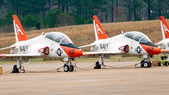 A lineup of T-45C Goshawk training jets stand at ready on the flight line at the Meridian Naval Air Station in Meridian, Miss. in this 2003 photo.