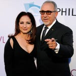 "Singer Gloria Estefan, left, poses with her husband, Emilio Estefan, at the opening of the 90th season of the Hollywood Bowl, in Los Angeles on June 17, 2011. Ana Villafane, a Cuban-American actress who attended the same Miami high school as Gloria Estefan, and Josh Segarra, an actor who stars on USA's ""Sirens,"" have been chosen to star on Broadway as Gloria and Emilio Estefan in ""On Your Feet!"" a musical based on the ground-breaking entertainers' lives."