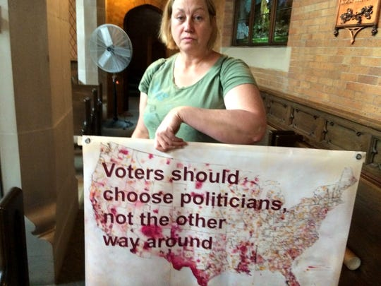 Beverly Speer of Madison, a member of Wisconsin Democracy Campaign, attends a rally Sunday evening at Plymouth Church in Milwaukee for the plaintiffs in Wisconsin's voter redistricting case.