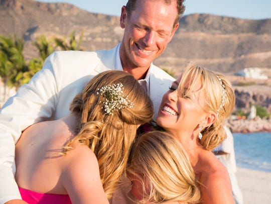 Eric Falbe, his wife, Carrie, and his daughters, Victoria