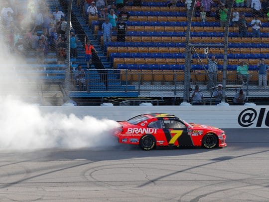 Justin Allgaier celebrates with a burnout after winning the Iowa 250. The No. 7 Chevrolet led 182 laps.