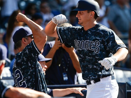 San Diego Padres' Alex Dickerson celevrates with hitting coach Alan Zinter after hitting a home run in the ninth inning against the New York Yankees  in a baseball game Sunday, July 3, 2016, in San Diego. (AP Photo/Lenny Ignelzi)