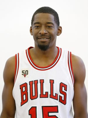 Chicago Bulls guard Jordan Crawford poses for a photo during media day Sept. 28, 2015, in Chicago.