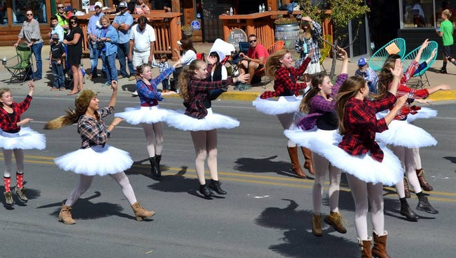 Ballerinas in tutus were part of the Dali Ballet Company float, but they showed their mountain roots by wearing flannel shirts.