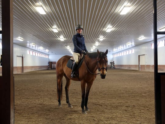 At Blumont Stables, in Victor, Erin Heberger rides, grooms and retrains her hose Nemo to jump.