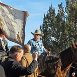 "Cliven Bundy, on horseback at center, joins the funeral procession for Arizona rancher Robert ""LaVoy"" Finicum in Kanab, Utah, Friday, Feb. 5, 2016. Hundreds of people packed a Mormon church in rural Utah for the viewing ceremony for the fallen spokesman of the Oregon armed standoff. Police shot and killed Finicum during a Jan. 26 traffic stop after they say he reached for a gun. His supporters called it an ambush.(AP Photo/Felicia Fonseca)"