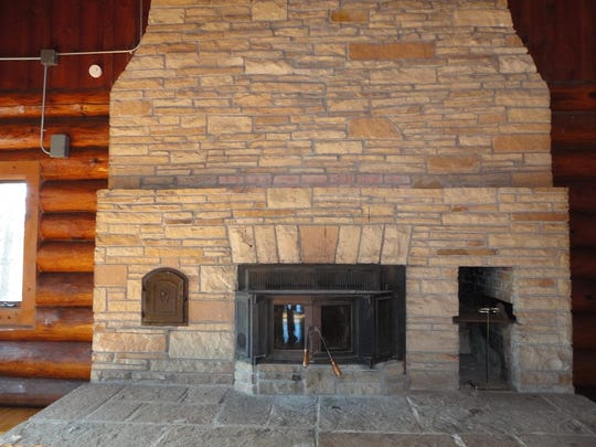 Many area couples have said their wedding vows in front of this massive fireplace in the first log cabin at YMCA Camp Alexander.