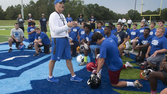 University of West Florida head coach Pete Shinnick, left, welcome this year's athletes to the annual football camp for high school students held on the UWF campus this weekend.