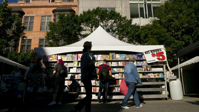 People shop for books at the Texas Book Festival at the Capitol in 2018.
