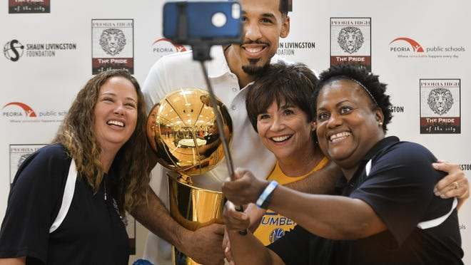 Shaun Livingston of the Golden State Warriors poses for a photo with friends Amanda Jacob, left, Laura June, and Ronda Guyton after bringing the Larry O'Brien Trophy of the NBA Championship to Peoria.