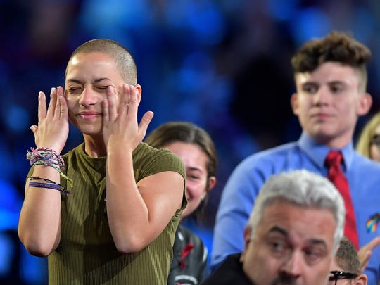 Marjory Stoneman Douglas High School student Emma Gonzalez wipes away tears during a CNN town hall meeting, Wednesday, Feb. 21, 2018, at the BB&T Center, in Sunrise, Fla.