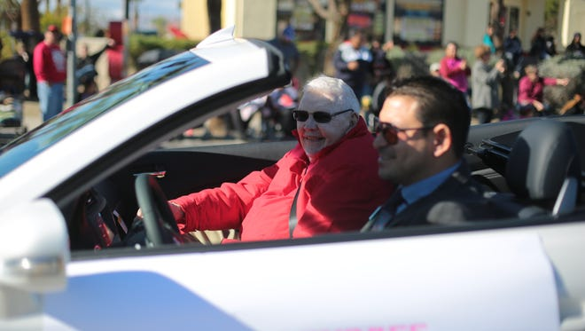 Steven Schick, pictured in December 2014, drives John Furbee in the Desert Hot Springs Holiday Parade.