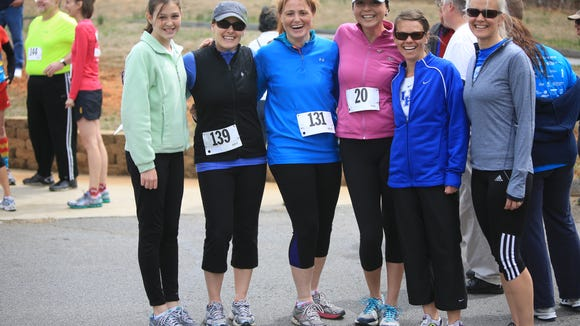 That's me, Karen, in the middle in pink, at the 14th annual Conquer a Cove 5K and Health Walk in April in Candler. It was a benefit for the Hope Chest for Women, and my first run after a breast cancer diagnosis in October 2013.
