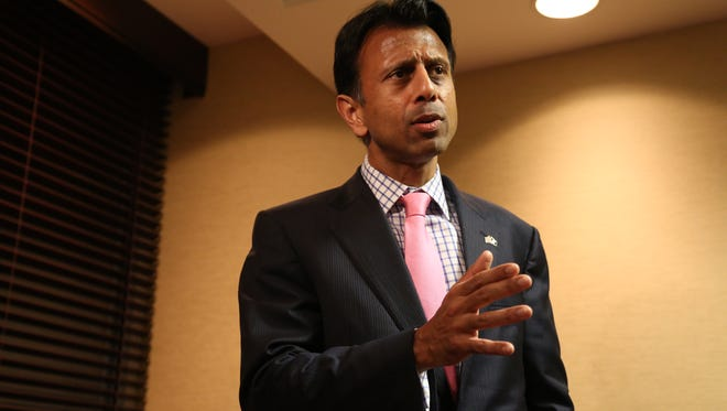 Governor of Louisiana Bobby Jindal speaks to the press on Tuesday, Dec. 16, 2014 before his appearance at the Polk County Republican's Holiday Party at the West Des Moines Marriott Hotel. Jindal told the press that he will decide early next year if he'll run for president.