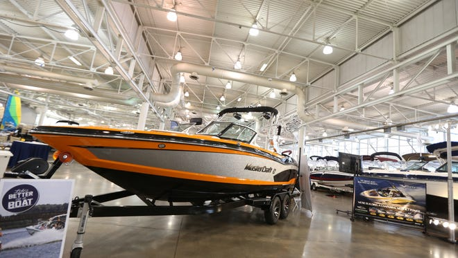 Low gas prices lift consumer confidence and make it easier for people to make big-ticket purchases, such as speedboats, says Bill Selesky, a leisure analyst in New York. A luxury boat sits on display at the Des Moines Boat & Outdoor Show on Jan. 9, 2015, at the Iowa State Fairgrounds in Des Moines, Iowa.