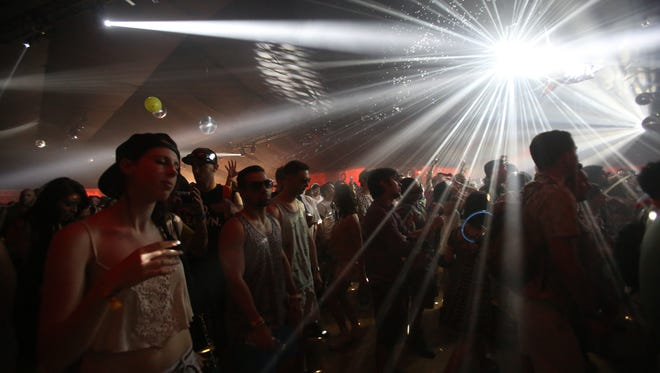 EDM fans enjoy beats by Damian Lazarus in the Yuma Tent.