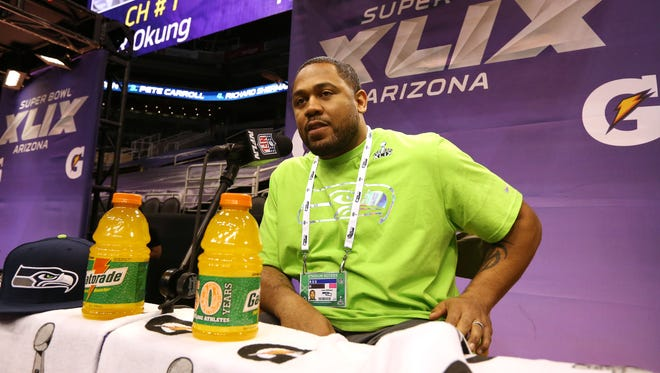 Seattle Seahawks defensive tackle Kevin Williams answers questions during Super Bowl media day on Tuesday, Jan. 27, 2015 in Phoenix.