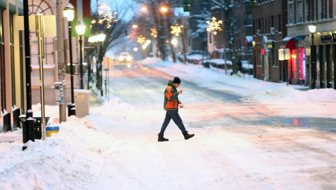 A man gets some coffee from the corner store early in the morning in White Plains Jan. 27, 2015.