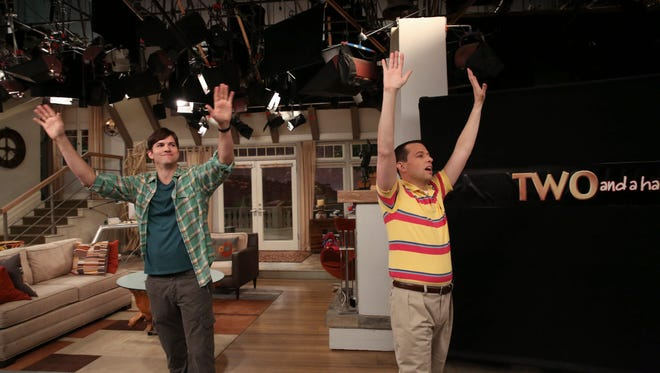 Ashton Kutcher and Jon Cryer greet the audience during the taping this month of the 'Two and a Half Men series finale.