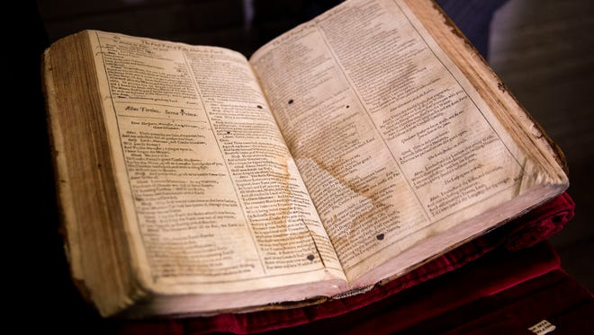 The First Folio of Shakespeare plays recently discovered in Saint-Omer in France, is displayed after a press conference at Shakespeare's Globe theatre in London, Monday, Feb. 23, 2015. The edition, which will be exhibited at the Globe in 2016 the year of the 400th anniversary of Shakespeares' death, is one of 230 copies of the 1623 Shakespeare First Folio and is notable for its scribbled stage directions.