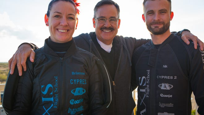 Brianne Thompson and Niklas Daniel pose with Mark Curtis in Eloy, Ariz.