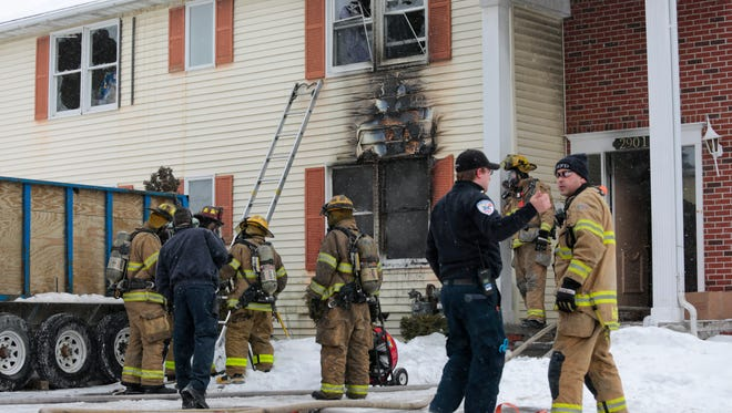Firefighters from Port Huron and Fort Gratiot work the scene of a fire Thursday at Heritage Way apartments, 2901 12th Ave. in Port Huron.