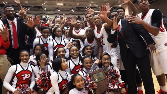 The Pike Red Devils celebrate their fifth consecutive