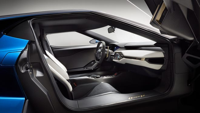 The interior on the all-new, two-seat, carbon-fiber, mid-engined Ford GT supercar is accessed by upward-swinging doors.