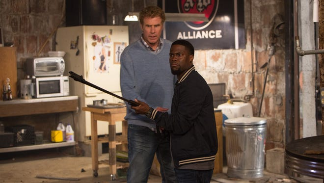 "Will Ferrell, left, is headed to prison and seeks coping skills from Kevin Hart in ""Get Hard."""