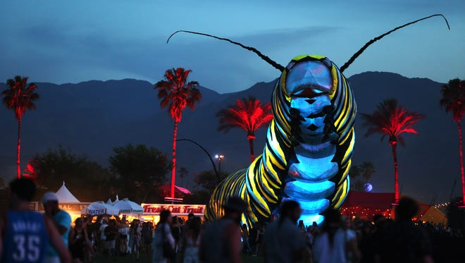 The mobile art installation Papilio Merraculous moves through the grounds during the Coachella Valley Music and Arts Festival at the Empire Polo Fields on Friday, April 10, 2015 in Indio, Calif.
