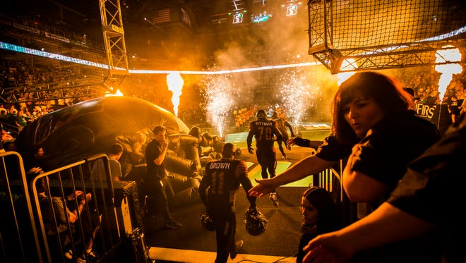 The Rattlers enter the field to play the Shock during the season opener at the US Airways Center in Phoenix, AZ on March 28, 2015.